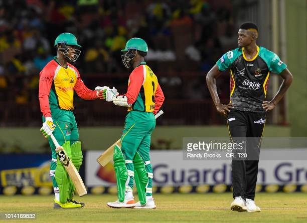 In this handout image provided by CPL T20 Shimron Hetmyer and Jason Mohammed of Guyana Amazon Warriors celebrate runs off Alzarri Joseph of St Kitts...