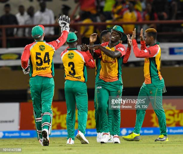 In this handout image provided by CPL T20 Shimron Hetmyer and Sherfane Rutherford of Guyana Amazon Warriors celebrate the dismissal of Anton Devchich...