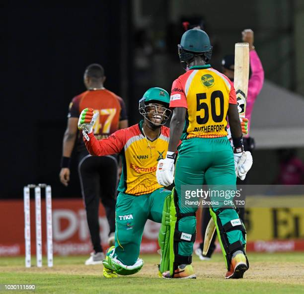 In this handout image provided by CPL T20 Shimron Hetmyer kneels in front Sherfane Rutherford of Guyana Amazon Warriors during match 30 of the Hero...