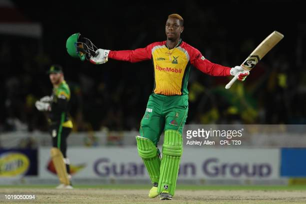 In this handout image provided by CPL T20 Shimron Hetmyer of Guyana Amazon Warriors reaches his century during the Hero Caribbean Premier League...