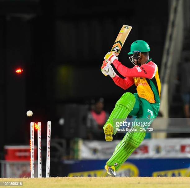 In this handout image provided by CPL T20 Shimron Hetmyer of Guyana Amazon Warriors is bowled by Carlos Brathwaite of St Kitts Nevis Patriots during...