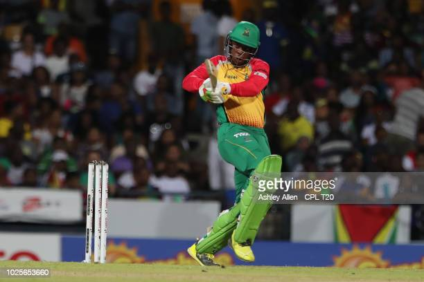 In this handout image provided by CPL T20 Shimron Hetmyer of Guyana Amazon Warriors plays a pull shot during the Hero Caribbean Premier League match...