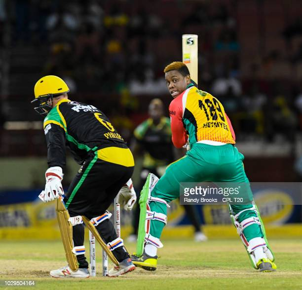 In this handout image provided by CPL T20 Shimron Hetmyer of Guyana Amazon Warriors hits pass Glenn Phillips of Jamaica Tallawahs during match 29 of...