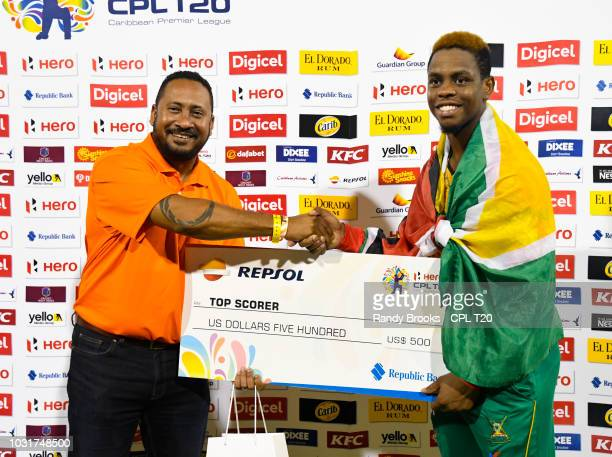 In this handout image provided by CPL T20 Shimron Hetmyer of Guyana Amazon Warriors receives the top score prize from Ryan Ramjit of Repsol at the...
