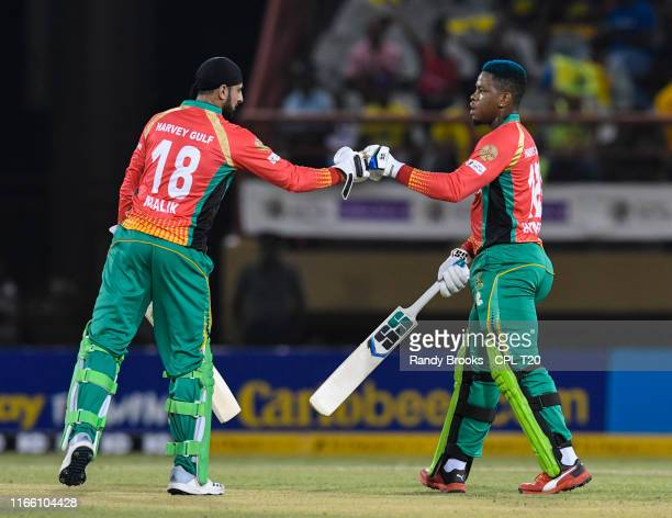 In this handout image provided by CPL T20 Shoaib Malik and Shimron Hetmyer of Guyana Amazon Warriors partnership during match 2 of the Hero Caribbean...