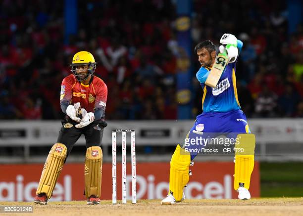 In this handout image provided by CPL T20 Shoaib Malik of Barbados Tridents hits 4 during Match 11 of the 2017 Hero Caribbean Premier League between...