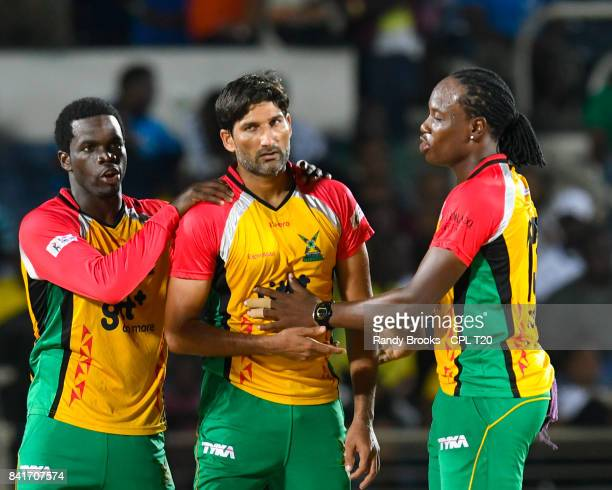 In this handout image provided by CPL T20 Sohail Tanvir Chadwick Walton and Steven Jacobs of Guyana Amazon Warriors celebrate the dismissal of Rovman...