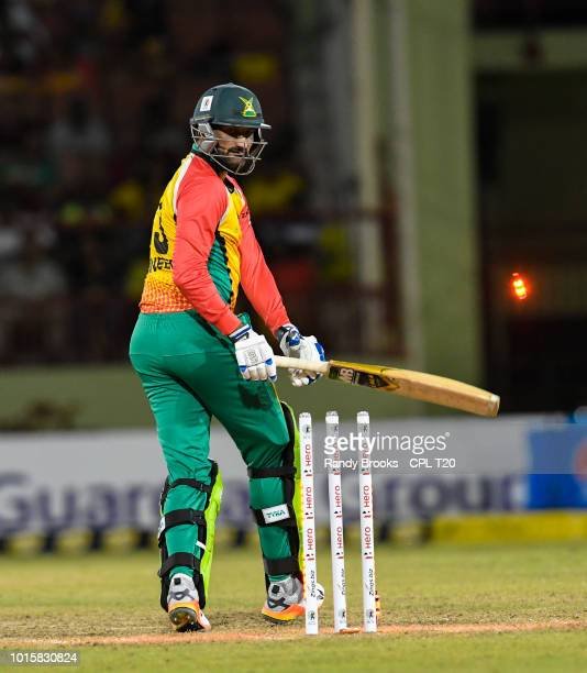 In this handout image provided by CPL T20 Sohail Tanvir of Guyana Amazon Warriors bowled by Wahab Riaz of Barbados Tridents during match 6 of the...