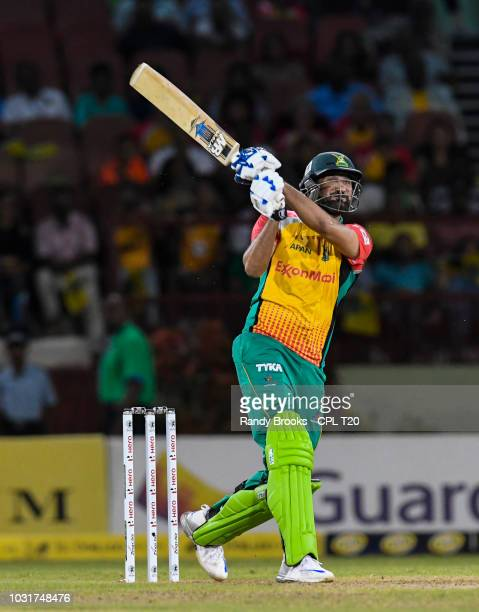 In this handout image provided by CPL T20 Sohail Tanvir of Guyana Amazon Warriors hits 6 to win the Hero Caribbean Premier League PlayOff match 31...