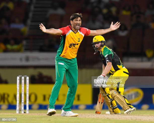 In this handout image provided by CPL T20 Sohail Tanvir of Guyana Amazon Warriors dismiss Glen Phillip of Jamaica Tallawahs lbw during Match 15 of...