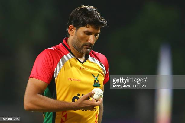 In this handout image provided by CPL T20 Sohail Tanvir of the Guyana Amazon Warriors walks back to his bowling mark during Match 25 of the 2017 Hero...