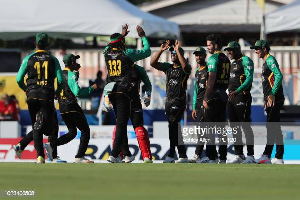 In this handout image provided by CPL T20 St Kitts and Nevis Patriots celebrate during the Hero Caribbean Premier League match between Barbados...