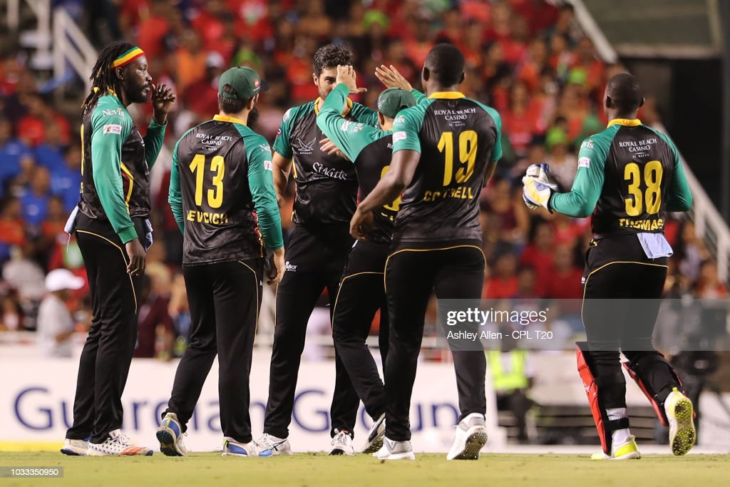 In this handout image provided by CPL T20, St Kitts and Nevis Patriots celebrate the wicket of Colin Munro during the Hero Caribbean Premier League Semi-Final match between Trinbago Knight Riders and St Kitts and Nevis Patriots at Brian Lara Stadium on September 14, 2018 in Tarouba, Trinidad and Tobago.