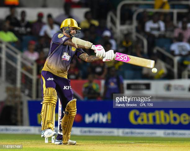 In this handout image provided by CPL T20, Sunil Narine of Trinbago Knight Riders hits 4 during match 10 of the Hero Caribbean Premier League between...