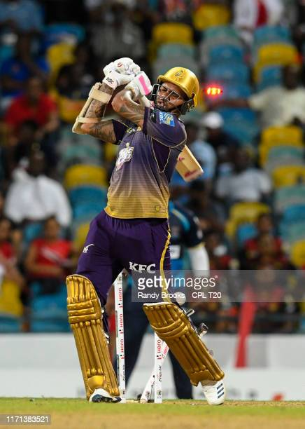 In this handout image provided by CPL T20, Sunil Narine of Trinbago Knight Riders is bowled by Jason Holder of Barbados Tridents during match 23 of...