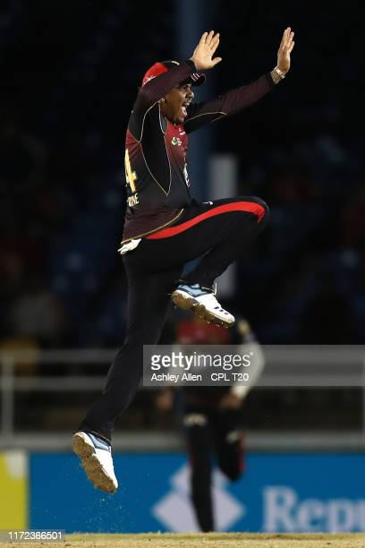 In this handout image provided by CPL T20, Sunil Narine of Trinbago Knight Riders celebrates a wicket during the Hero Caribbean Premier League match...