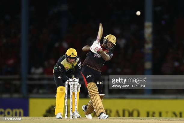 In this handout image provided by CPL T20, Sunil Narine of Trinbago Knight Riders hits four during the Hero Caribbean Premier League match between...
