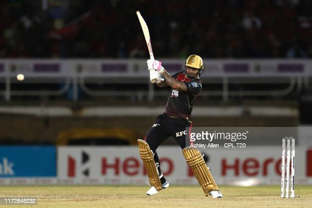 In this handout image provided by CPL T20, Sunil Narine of Trinbago Knight Riders bats during the Hero Caribbean Premier League match between...