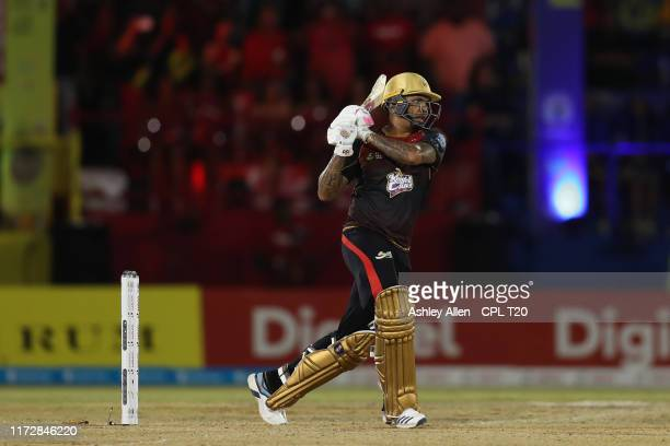 In this handout image provided by CPL T20, Sunil Narine of Trinbago Knight Riders hits out during match between Trinbago Knight Riders and Jamaica...