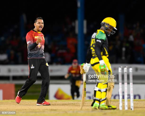In this handout image provided by CPL T20, Sunil Narine of Trinbago Knight Riders celebrates the dismissal of Andre Mccarthy of Jamaica Tallawahs...