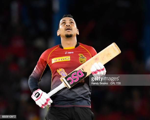 In this handout image provided by CPL T20, Sunil Narine of Trinbago Knight Riders celebrates his half century during Match 11 of the 2017 Hero...
