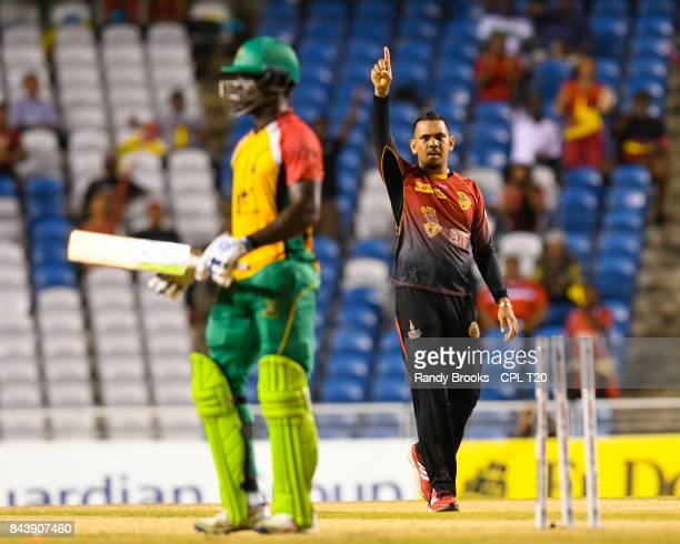 In this handout image provided by CPL T20, Sunil Narine of Trinbago Knight Riders celebrates the dismissal of Chadwick Walton of Guyana Amazon...