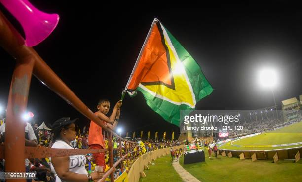 In this handout image provided by CPL T20 Supporter of Guyana Amazon Warriors waves his flag during match 4 of the Hero Caribbean Premier League...