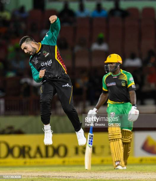 In this handout image provided by CPL T20 Tabraiz Shamsi of St Kitts Nevis Patriots celebrates the dismissal of Rovman Powell of Jamaica Tallawahs...