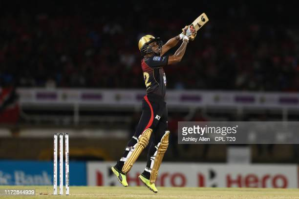 In this handout image provided by CPL T20 Tion Webster of Trinbago Knight Riders plays an attacking shot during the Hero Caribbean Premier League...