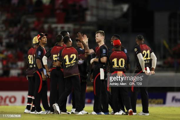 In this handout image provided by CPL T20 Trinbago Knight Riders celebrate a wicket during the Hero Caribbean Premier League match between Trinbago...