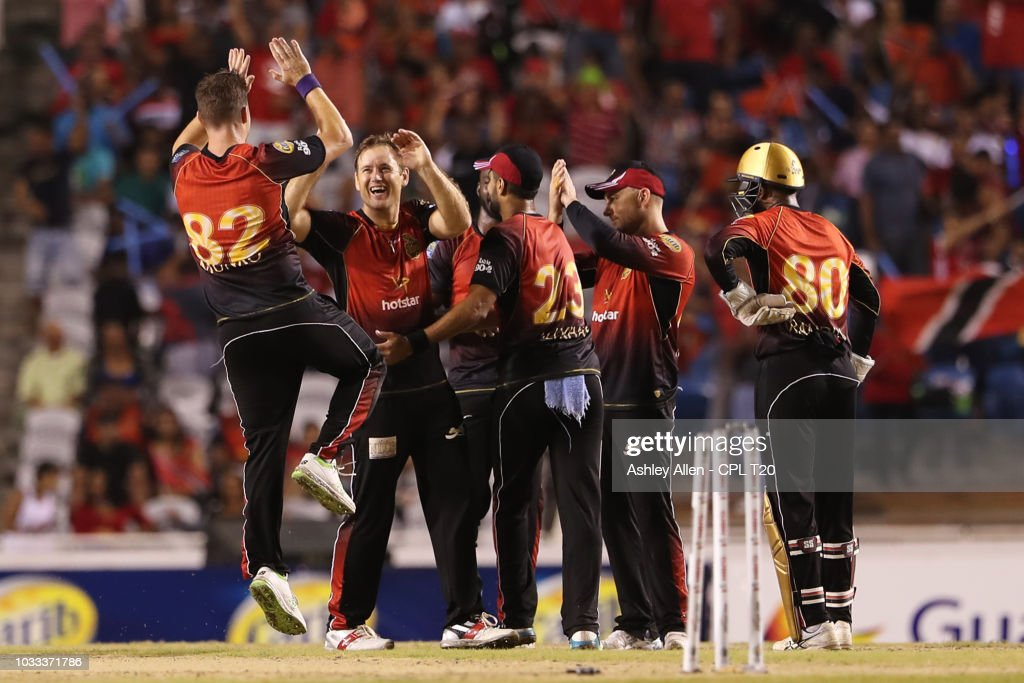 In this handout image provided by CPL T20, Trinbago Knight Riders celebrate the wicket of Devon Thomas of St Kitts and Nevis Patriots during the Hero Caribbean Premier League Semi-Final match between Trinbago Knight Riders and St Kitts and Nevis Patriots at Brian Lara Stadium on September 14, 2018 in Tarouba, Trinidad and Tobago.