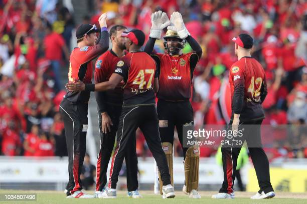 In this handout image provided by CPL T20 Trinbago Knight Riders celebrate the wicket of Shimron Hetmyer during the Hero Caribbean Premier League...