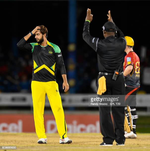 In this handout image provided by CPL T20 Umpires Nigel Duguid signals 6 runs off Imad Wasim of Jamaica Tallawahs during Match 7 of the 2017 Hero...