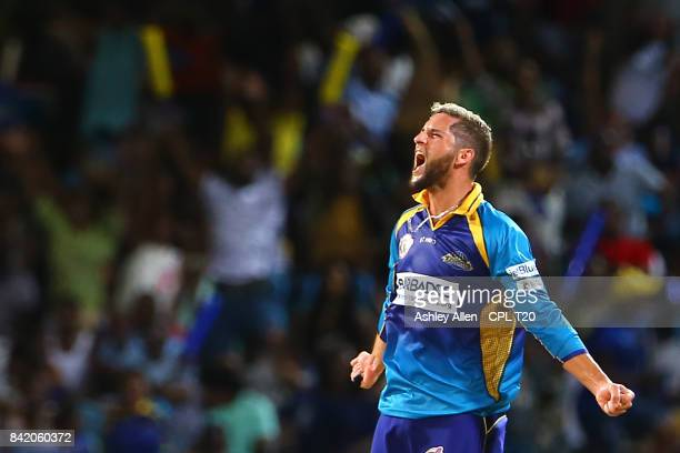 In this handout image provided by CPL T20 Wayne Parnell of the Barbados Tridents celebrates the wicket of Ashley Nurse of the Trinbago Knight Riders...