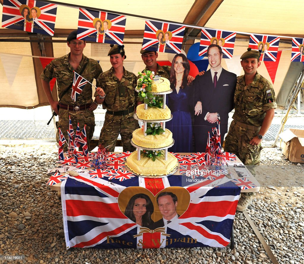 In this handout image provided by Crown Copyright, Members of 4 SCOTS pose with a wedding cake that was made by KBR, who provide the catering in Task Force Helmand on April 29, 2011 in Lashkar Gah, Afghanistan. The marriage of the second in line to the British throne is to be led by the Archbishop of Canterbury and will be attended by 1900 guests, including foreign Royal family members and heads of state. Thousands of well-wishers from around the world have also flocked to London to witness the spectacle and pageantry of the Royal Wedding. (LA(Phot) Burke/Mandatory Credit MOD/Crown Copyright via Getty Images)