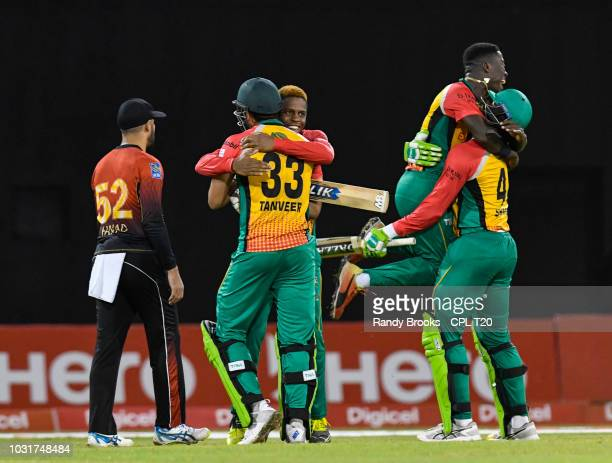 In this handout image provided by CshePL T20 Shimron Hetmyer Sohail Tanvir Sherfane Rutherford and Romario Shepherd of Guyana Amazon Warriors...