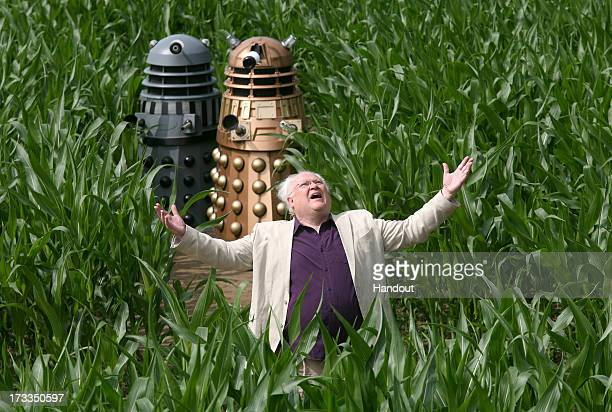 In this handout image provided by David Leon/Partners PR Colin Baker who played the Sixth Doctor poses with Daleks amongst the York Maize maze which...