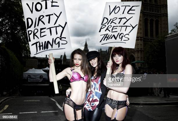 In this handout image provided by Dirty Pretty Things models pose in Dirty Pretty Things lingerie with designer Claire Merry opposite the Houses of...