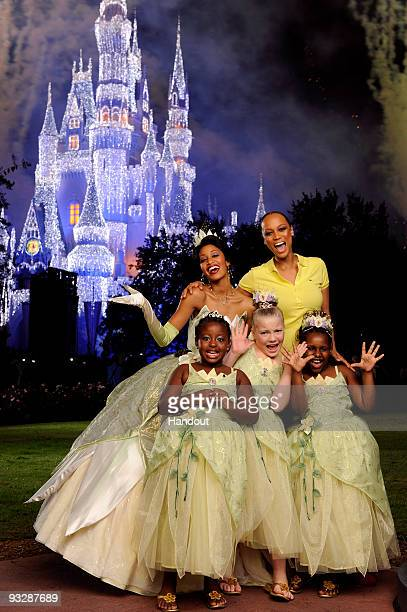 In this handout image provided by Disney Emmy Awardwinning talk show host and supermodel Tyra Banks poses with Disney's newest princess Tiana and...