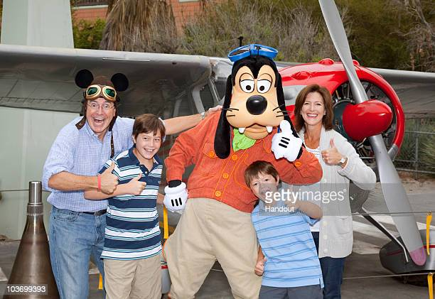 In this handout image provided by Disney Emmynominee Stephen Colbert wife Evelyn Colbert and sons Peter Colbert and John Colbert pose with Goofy...
