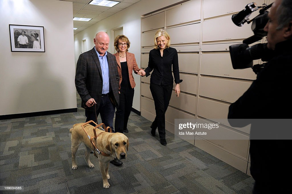 In this handout image provided by ABC, Former Congresswoman Gabrielle Giffords (C), who was critically injured two years ago when a gunman opened fired in Tucson, Arizona, and her husband, astronaut Mark Kelly walk with Diane Sawyer (R) as they prepare to speak about the need for changes in gun control laws and greater awareness of mental health issues on January 5, 2013 in New York City. The interview will air on all ABC News programs and platforms on January 8.