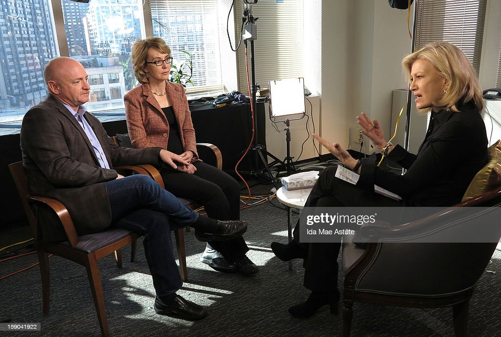 In this handout image provided by ABC, Former Congresswoman Gabrielle Giffords, who was critically injured two years ago when a gunman opened fired in Tucson, Arizona, and her husband, astronaut Mark Kelly talk to Diane Sawyer about the need for changes in gun control laws and greater awareness of mental health issues on January 5, 2013 in New York City. The interview will air on all ABC News programs and platforms on January 8.