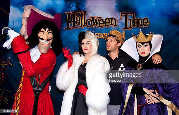 In this handout image provided by Disney 'Glee' star Matthew Morrison celebrates Halloween Time with Captain Hook from 'Peter Pan' Cruella de Vil and...