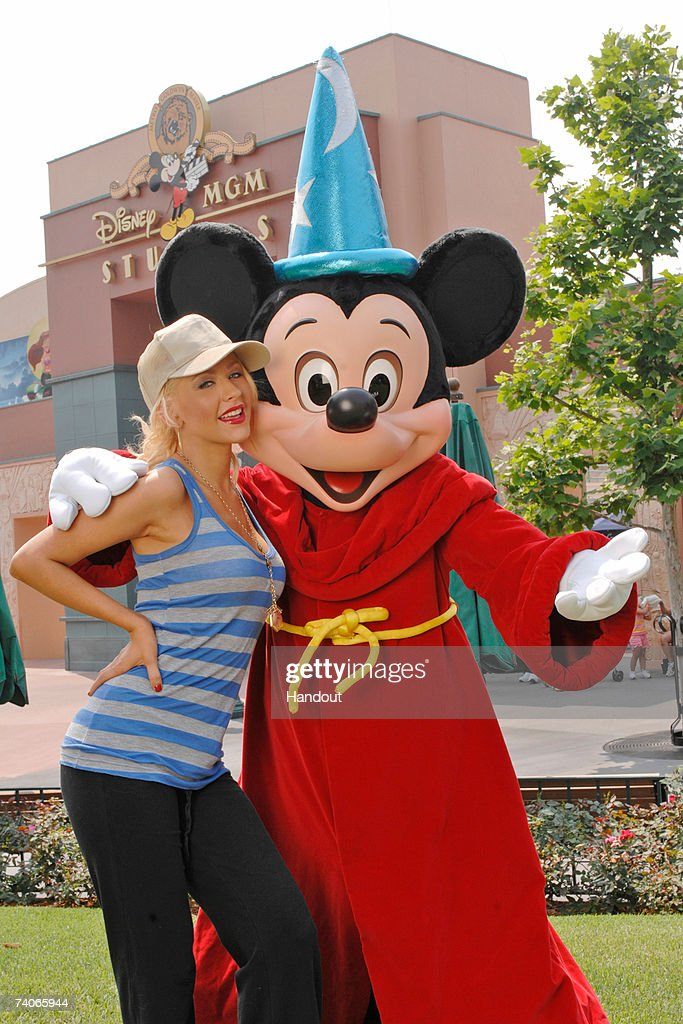 In this handout image provided by Disney, grammy Award-winning artist Christina Aguilera poses with Mickey Mouse at the Disney-MGM Studios on May 3, 2007 in Lake Buena Vista, Fla. It was a 'homecoming' for Aguilera, who taped the Disney Channel's 'The New Mickey Mouse Club' series at the Disney-MGM Studios as a child star in the early 1990s.
