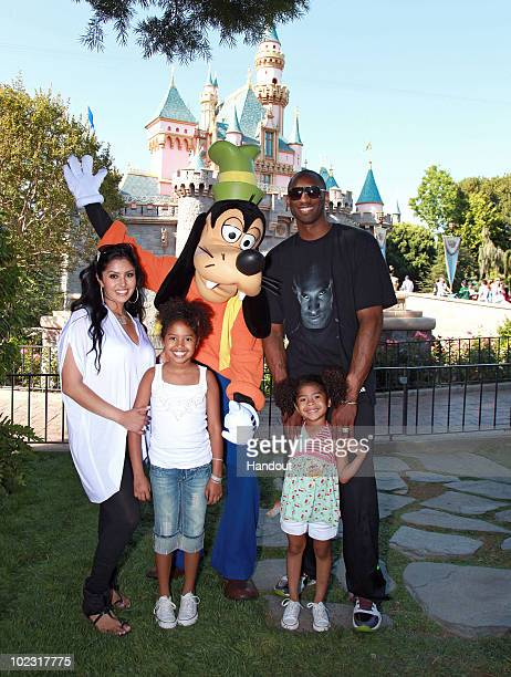 In this handout image provided by Disney, Los Angeles Lakers star Kobe Bryant , wife Vanessa Bryant and daughters Natalia and Gianna celebrate the...