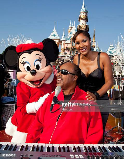 In this Handout image provided by Disney Minnie Mouse music legend Stevie Wonder and his daughter Aisha Morris take a break during a taping of the...