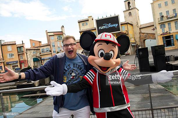 In this handout image provided by Disney Parks actor Drew Carey host of 'The Price is Right' poses with Mickey Mouse at a kickoff celebration for the...