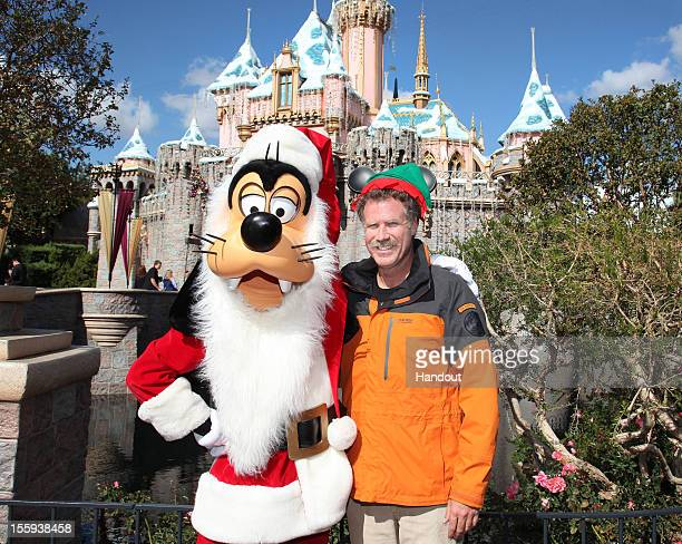In this handout image provided by Disney Parks actor Will Ferrell star of the popular holiday film 'Elf' dons a Mickey Mouseinspired Elf hat and...
