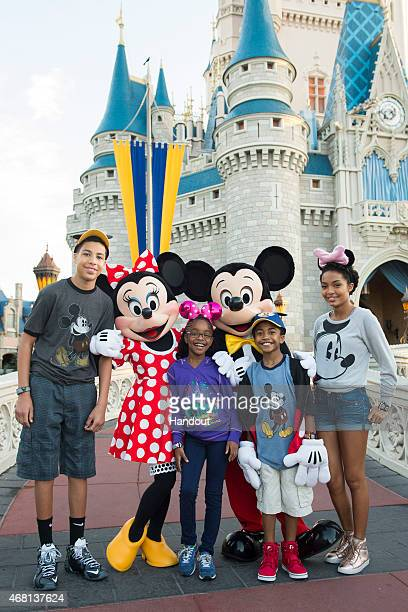 In this handout image provided by Disney Parks, Actors Marcus Scribner, Marsai Martin, Miles Brown and Yara Shahidi, from the cast of the ABC series...