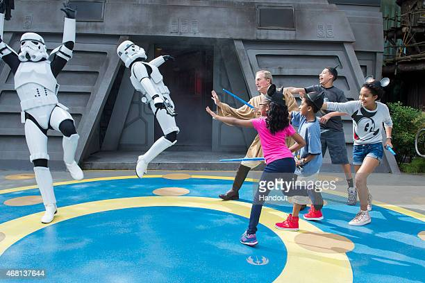 In this handout image provided by Disney Parks, Actors Marsai Martin, Miles Brown, Marcus Scribner and Yara Shahidi, from the cast of the ABC series...